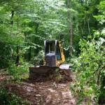 Un tânăr a murit strivit de buldozer